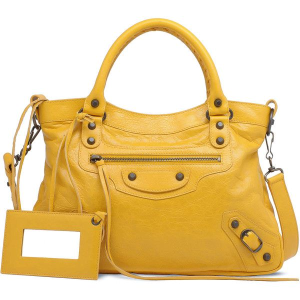 One of these days, I will own one of the Belenciaga bags....even if I have to roll around in my wheelchair at the home with it.