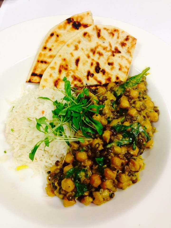 Roasted cauliflower and yellow lentil curry with braised coconut rice and house made flat breads