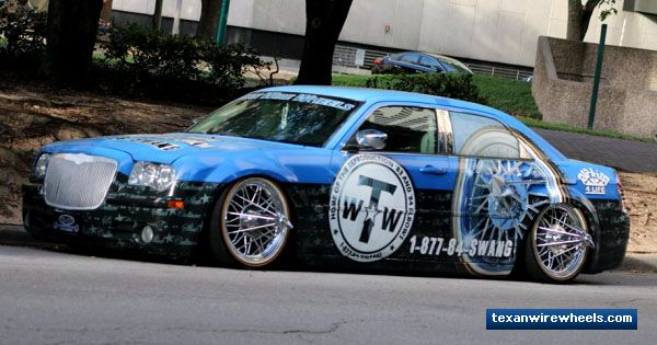 Several years ago, Texan Wire Wheels put a set of 22 inch 84s® Standard Poke® Wire Wheels on its wrapped 2006 Chrysler 300C corporate car. Today, our corporate wrapped car custom wire wheels of choice is a set of vintage 20 inch 84s® Giraffe Poke® G12 Wire Wheels. Specializing in 30 Spoke elbow wheels, Texan Wire Wheels already offers a variety of 83s and 84s elbow wire wheels in 15-inch, 17-inch, 20-inch and 22-inch sizes for its wire wheels for cars line of products. The Texan Wire Wheels…