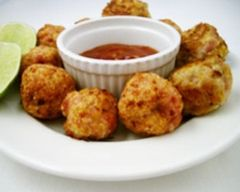 Chicken balls make a tasty party plate for grown-ups and kids. This recipe is healthier than most because these chicken balls are oven baked not fried.