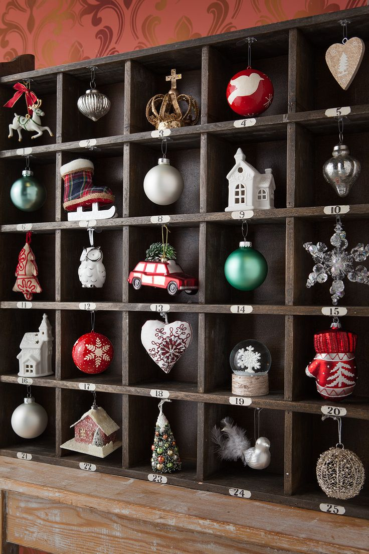 Christmas ornament display case - This Wood Cubby From Homegoods Made The Perfect Diy Ornament Calendar Just Add Hooks