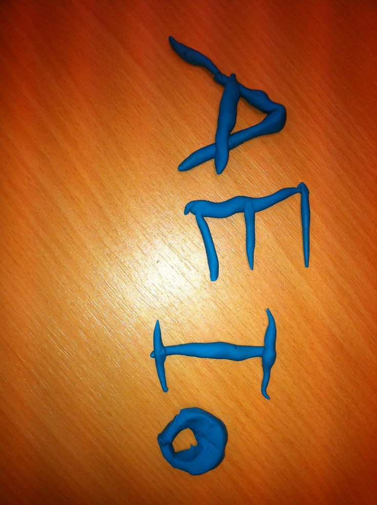using playdough to practice writing capital letters