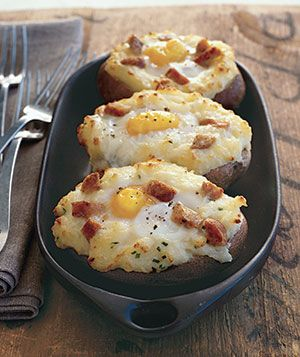 Twice-baked potatoes, topped with an egg, are mixed with butter and Parmesan cheese
