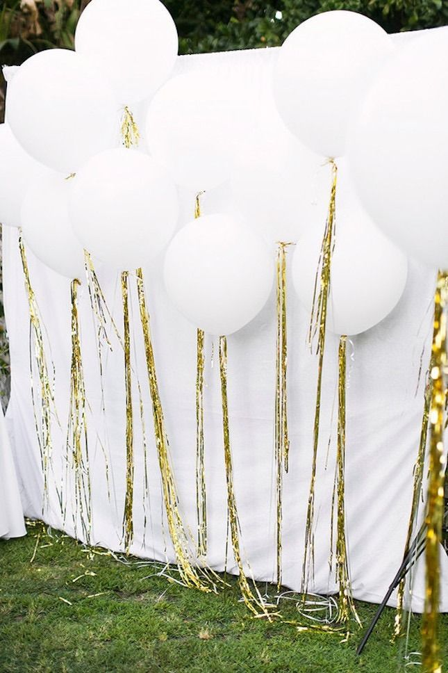 Bookmark this for 17 fun ideas to bring the balloon wall trend to your next party like a set of these golden tassel white balloons.