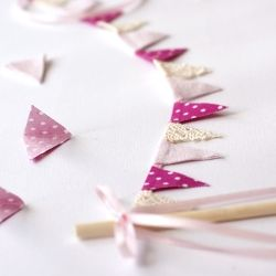 See how to make your own adorable bunting cake banner.