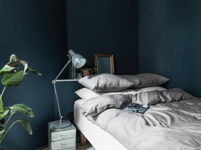 A striking, small bedroom in dark blue