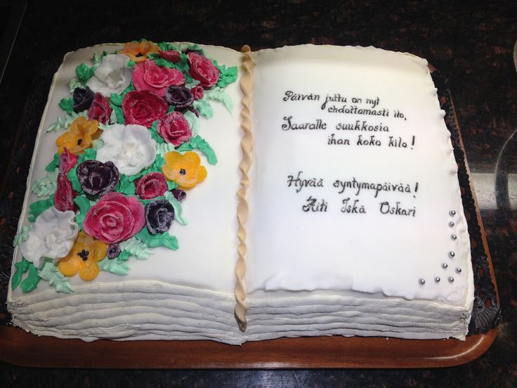 Birthday cake which looks like an open book. Flowers (roses incl. Christmas roses) are look like after cold night. Poem at right side.