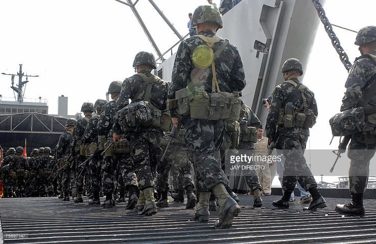 A battalion of Philippine Marines embark on a ship to be deployed to the southern island of Basilan in Manila, 01 August 2007 where troops are building up their forces to hunt down Muslim guerrillas who killed 14 Marines in an ambush on July 10th. The Muslim separatist Moro Islamic Liberation Front (MILF), which is engaged in peace talks with the government, has admitted killing the Marines but says the soldiers intruded into their territory. AFP PHOTO/Jay DIRECTO