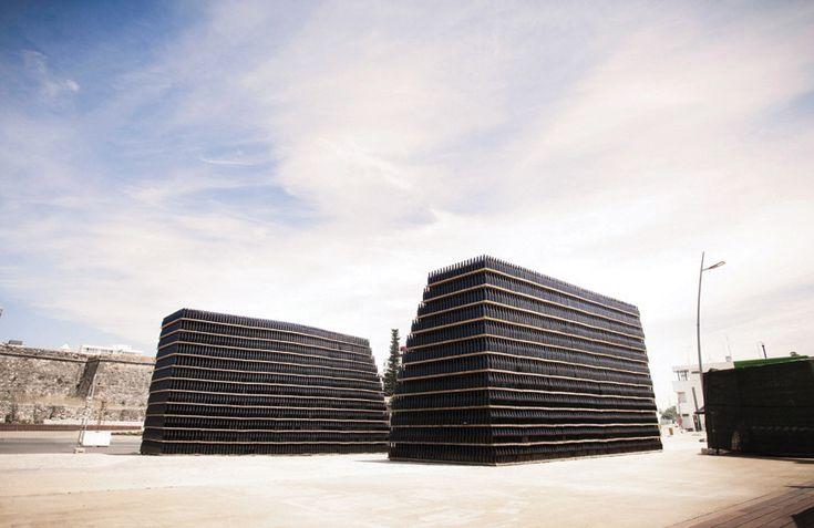 fahr0213's 50,000 glass bottles entranceway for figueira da foz festival - designboom | architecture