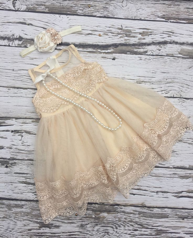 A personal favorite from my Etsy shop https://www.etsy.com/listing/399017747/flower-girl-dress-champagne-flower-girl