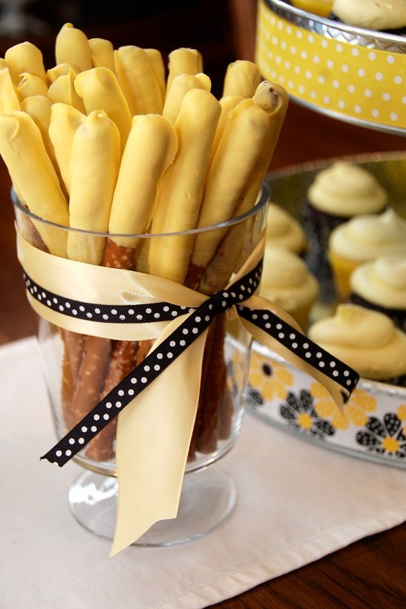 yellow dipped pretzels for a bumble bee party! Tie black and yellow ribbon around the glass #BirthdayExpress #BumbleBee