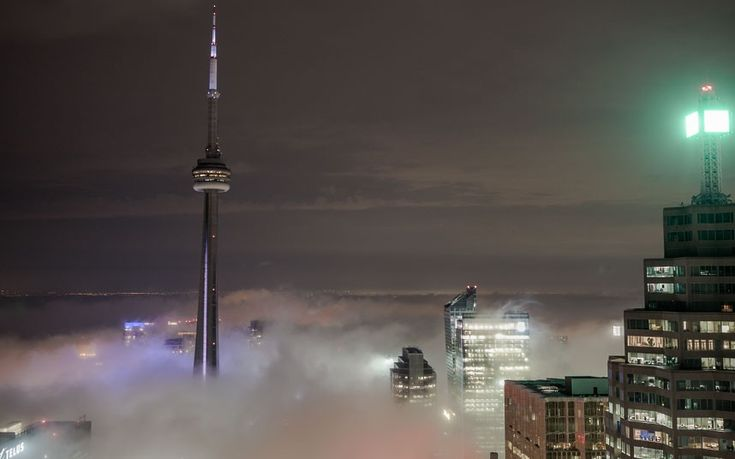 I'll be here in a couple weeks ... The CN Tower rises above mist covering the skyline of Toronto