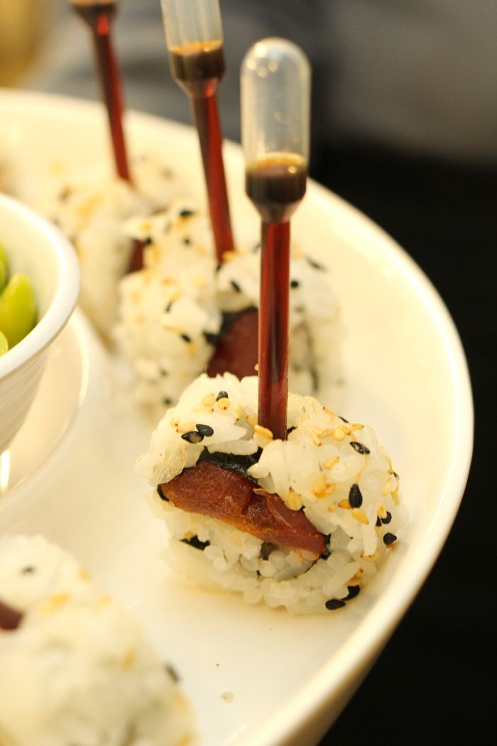 Sushi with pipettes of soy sauce. #southerncharmmoderntwist #events
