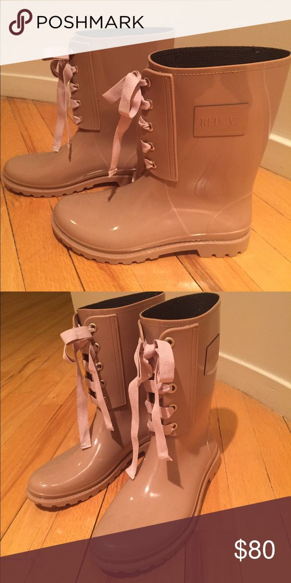 """Valentino """"Red"""" Rain boots Never worn, light pink with ribbon ties at the front and V logo on the sides RED Valentino Shoes Winter & Rain Boots"""
