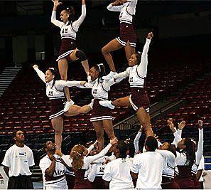 Advanced (college) level stunt/ one legged stunt/ three high stunt/ combining or locking stunt/ pyramid