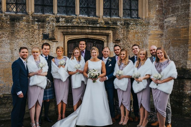 The bride and groom with all the bridesmaids and their partners. Photo by Benjamin Stuart Photography #weddingphotography #bridalparty #bridesmaids #groupphoto #churchwedding #justmarried #friends