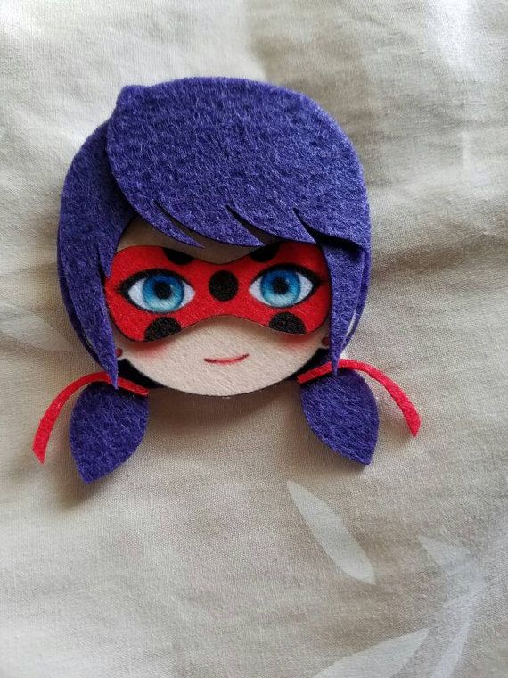 Miraculous Ladybug Felt Pins.  Available pins are: - Miraculous Ladybug - Chat Noir (Please Pick One character only if you want to buy multiple ones please add to quantity and send a note to seller when you purchase)