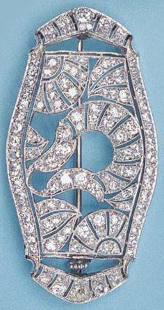 An Art Deco platinum, gold and diamond brooch, circa 1930. Designed as an…
