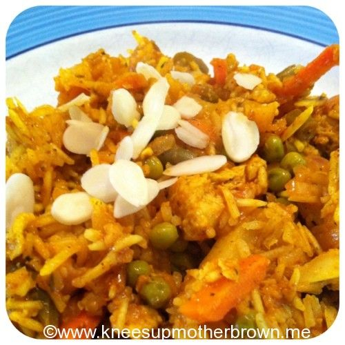 Quorn Biriyani – A Slow Cooker Recipe  1 pack fresh quorn chicken style pieces   1 small red onion (chopped)   250g easy cook basmati rice   200g frozen mixed vegetables (peas, carrots, sweet corn, pepper etc)   Chopped dried apricots (a couple of handfuls)   Flaked almonds (a good handful)   Jar of tikka masala paste   1 vegetable stock cube   650ml boiling water