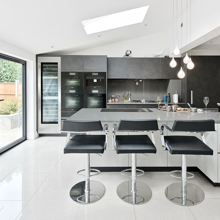 Chef, mother and owner of Mere, Monica Galetti designed her kitchen to balance her profession with her personal life. Sleek handleless units add a minimalistic feel to this contemporary space