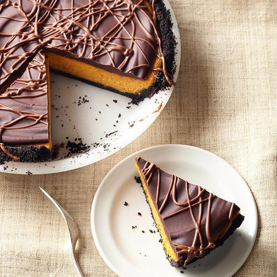 Decadent chocolate glaze adds something extra to this Pumpkin Pie Cheesecake. See 40 more yummy pumpkin recipes: http://www.bhg.com/thanksgiving/recipes/pumpkin-recipes/?socsrc=bhgpin082012PumpkinPieCheesecake#page=2