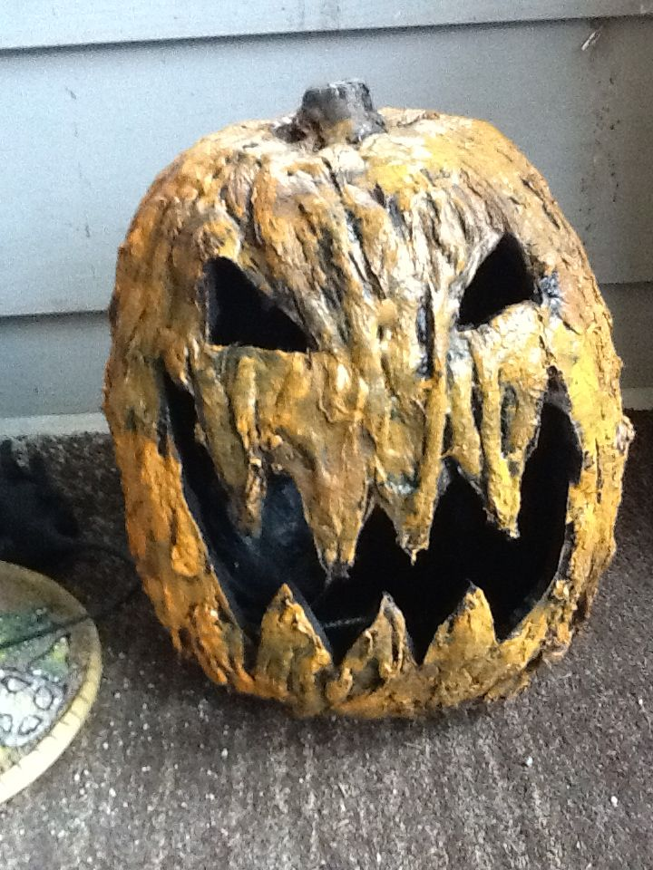how to make an easy rotting pumpkin tut~use a fake pumpkin, coat with modge podge, layer on stretched out cotton balls. Paint black, let dry. Layer on another coat of modge podge, let dry, then paint overcoat orange.