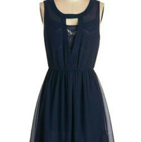 Dot and Bo dress from Modcloth A beautiful navy blue dress,  worn once and dry cleaned.  Elastic cinched waist, a gorgeous lace spaghetti-strap top with plain skirt under a sheer dress. Would fit a size 10 to 14 comfortably. ModCloth Dresses Mini