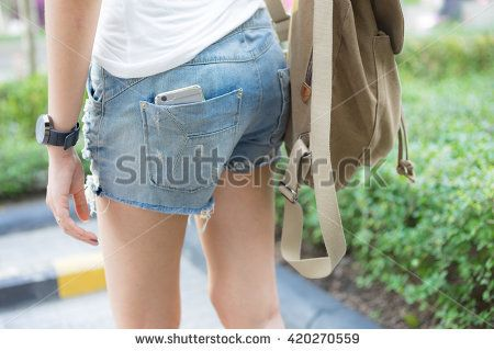 Smart phone in pocket jeans