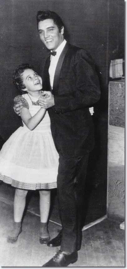 Brenda Lee meets Elvis....look at the admiration on her little face!