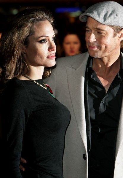 """Brad Pitt gives Angelina Jolie an admiring look at the London premiere of """"Beowulf"""" on Nov. 11, 2007."""