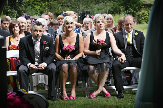 Black bridesmaid dresses with hot pink accents in shoes and bouquets / nealejames.com