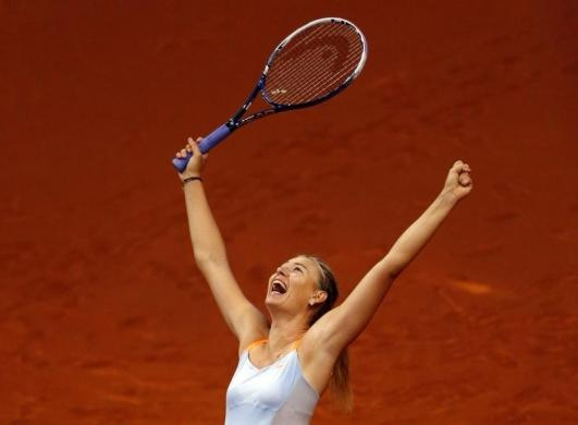 Russias top seed and holder Maria Sharapova celebrates her victory against Chinas Li Na in the final of the Stuttgart tennis Grand Prix April 28, 2013.  REUTERS/Michael Dalder