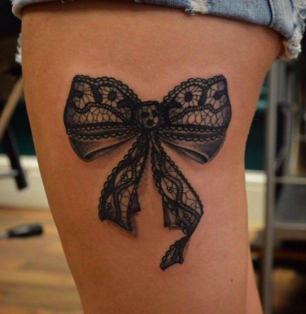 Tattoo schwarze Schleife Bein