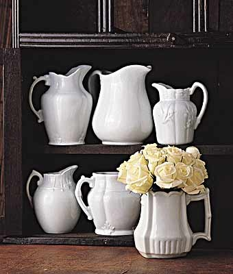FARMHOUSE – INTERIOR – early american decor inside this vintage farmhouse seems perfect with white ironstone pitchers.