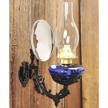 The complete Victorian Lamp set includes: Lamp - Primitive hand-molded glass reproduction lamp is just like the original, including the bubbles and imperfections. Choose between the clear or cobalt blue set. Cast Iron Wall Bracket- Cast exclusively for us from a 19 th century pattern, includes mounting plate Mercury-Style Reflector- Focuses light where needed Mounting Kit - Hardware for mounting.