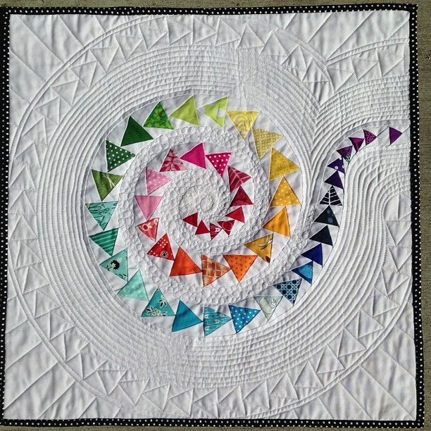 Spiral Geese done! FLiQS by Better Off Thread.  Amazing!