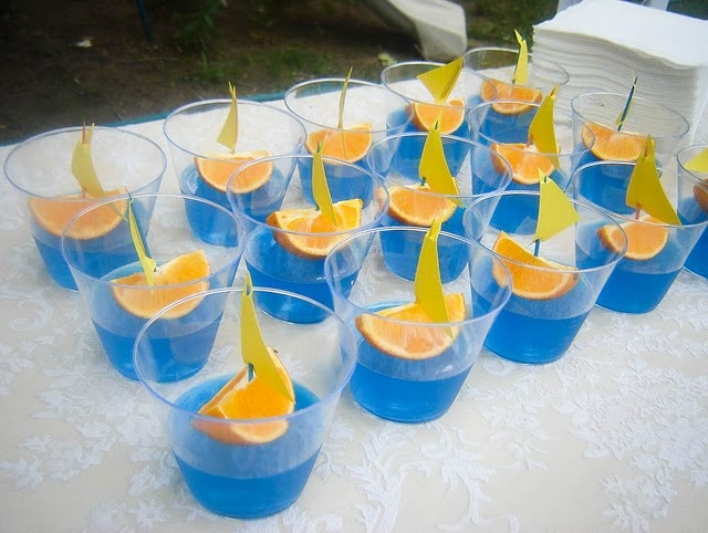 little oranges, toothpicks, and blue jello. also instead of jello you could use blue Gatorade