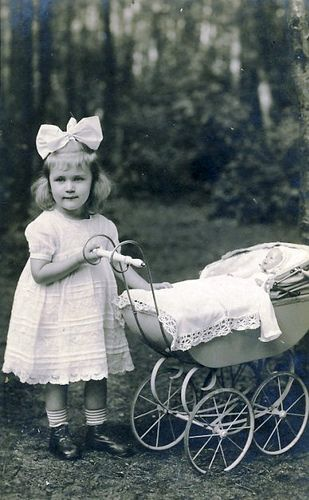 A girl and her dolly.