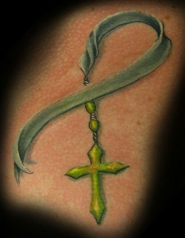 Beautiful cancer ribbon tattoo..i like it but with a pentagram instead of a cross. Body Artistics! | tattoos picture cancer ribbon tattoos