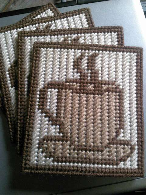Coffee coasters...handmade plastic canvas; includes 4 coasters and a holder. Warm brown, light tan, and brown. Mug not included. This is already made by hand and ready to ship. As always, shipping is combined.