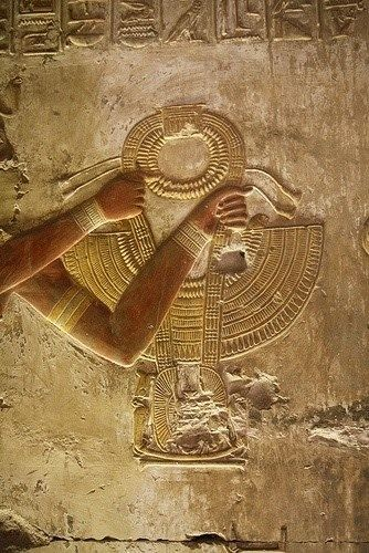 The king Sethy I is presenting the collar, Amun shrine of the temple of Sethy I at Abydos.
