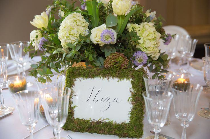 Boho wild and flowing wedding table centre flowers with moss decorated table names Joanna Carter Wedding Flowers