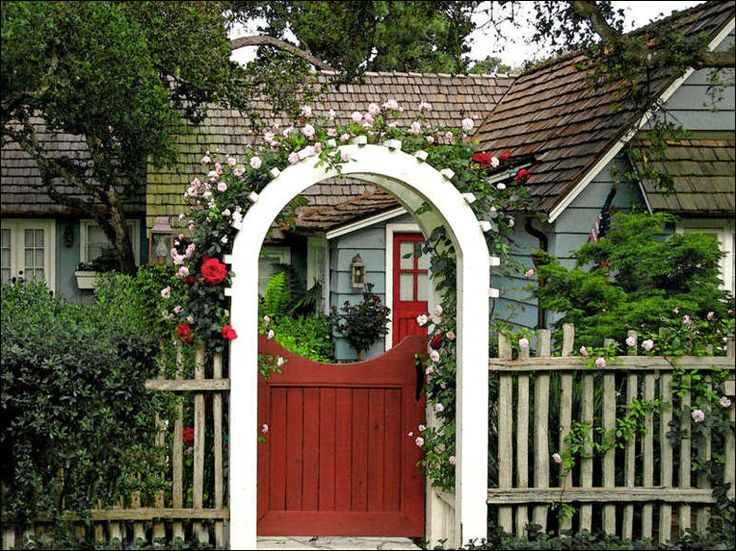 this little cottage with its red gate rose covered arbor and no parking sign always makes me reach for my camera i love the repeated touches