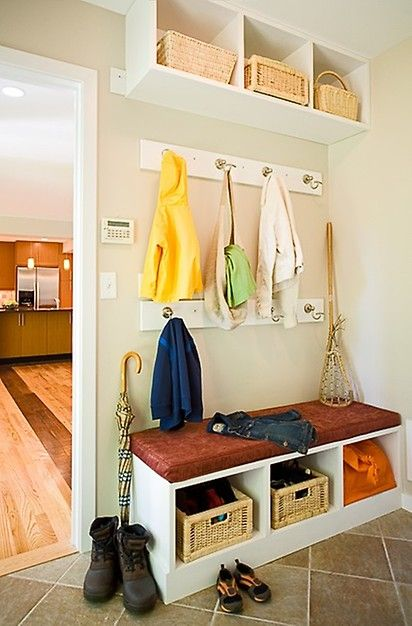What a sweet entryway organizer. With all of these cubbies and baskets it's not hard to keep your entryway clean ♥ Click this pin to see the kitchen eating nook in this home