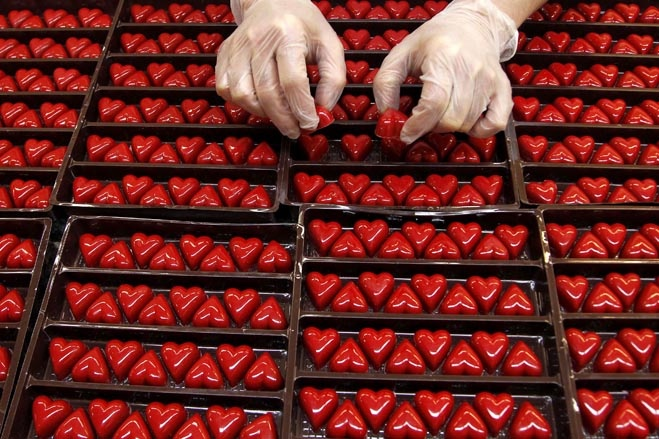 A worker adjusted heart-shaped pralines in a Wittamer chocolate boutique in Brussels.