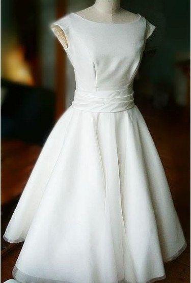 Simple Ivory tea length Chiffon wedding dress, ball gown, lovey wedding dress with cap sleeves,outdoor/beach/destination wedding dress. $186.99, via Etsy.