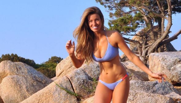 Super fit Instagram star shares a photo of her stomach rolls to show that no one's perfect