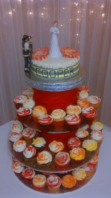 Firefighter wedding cake and cupcakes                                                                                                                                                      More