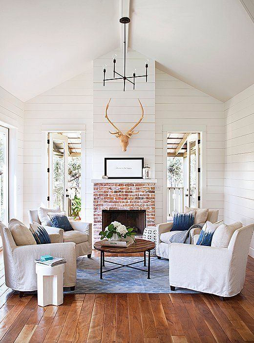 A trophy head is a classic adornment for above the fireplace and a rustic alternative to art or a mirror.