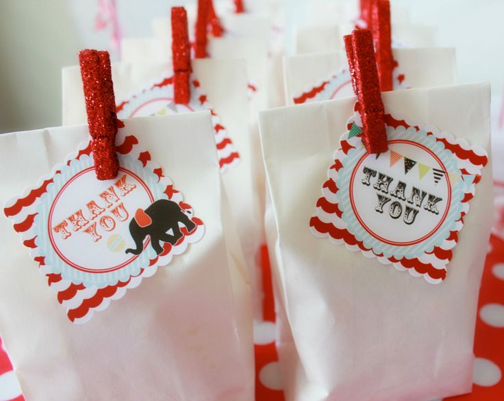 Circus Favor Tags - fill small white paper bags with popcorn or other treats and use glittery red clothespins to attach tags. Super easy and cute!